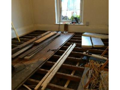 Floor being lifted in old reception