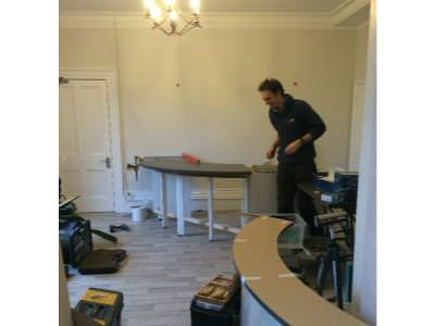 New reception desk being installed by Andy seal , Vicki's husband